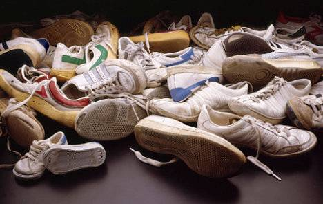 pile of old used sneakers